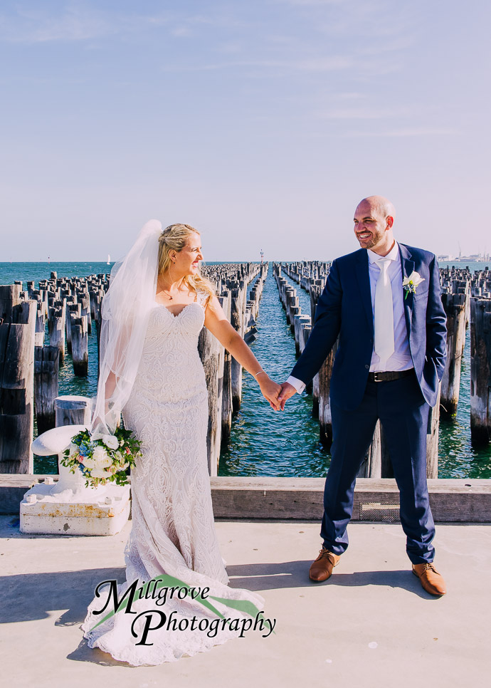 Portrait of a bride and groom by the ocean and beach