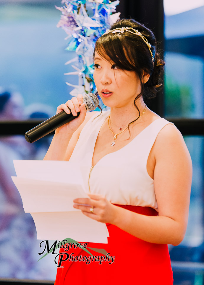 Guests giving speeches at an Eastern Golf Club wedding