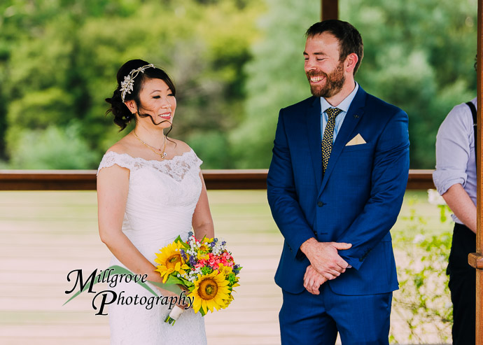 A bride and groom looking at each other