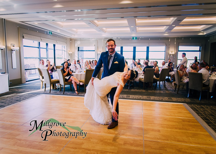 Groom dips his new bride during first dance at Eastern Golf Club wedding