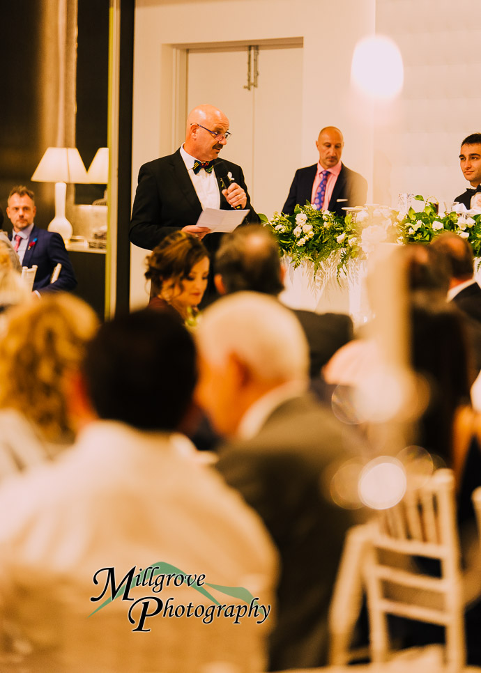 Guests making speeches at a wedding reception