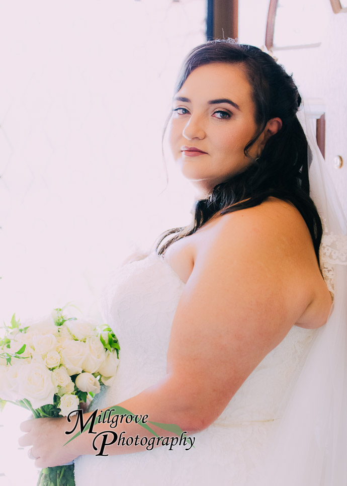 A bride holding flowers