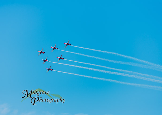 6 planes in formation against a blue sky