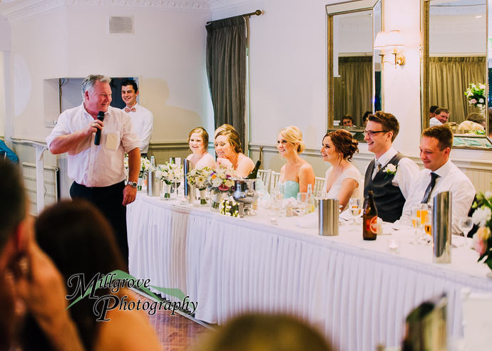 Guests giving speeches at a wedding