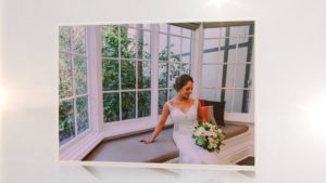 Bride sitting on a sofa in a picture window