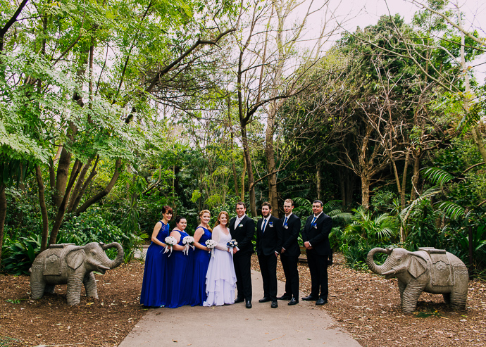 Melbourne Zoo Weddings - A bridal party standing in a garden