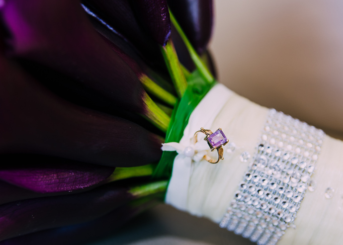 A purple ring attached to a bride's bouquet