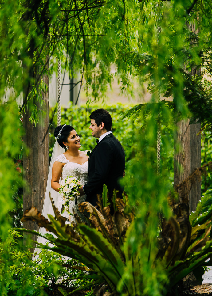 A bride and groom with trees around them
