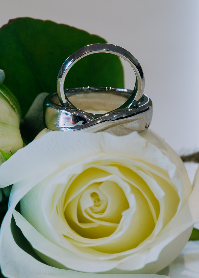 Wedding rings on a white flower