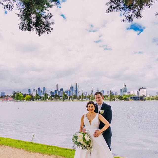 Two Ton Max wedding - A bride and groom walking next to Albert Park LAke, near Carousel in St Kilda