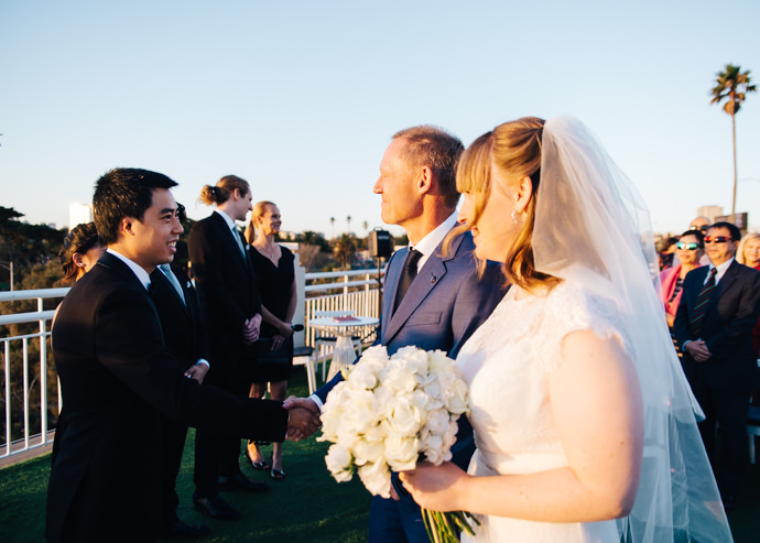 Father of the bride shaking the groom's hand at a Royal Melbourne Yacht Squadron wedding