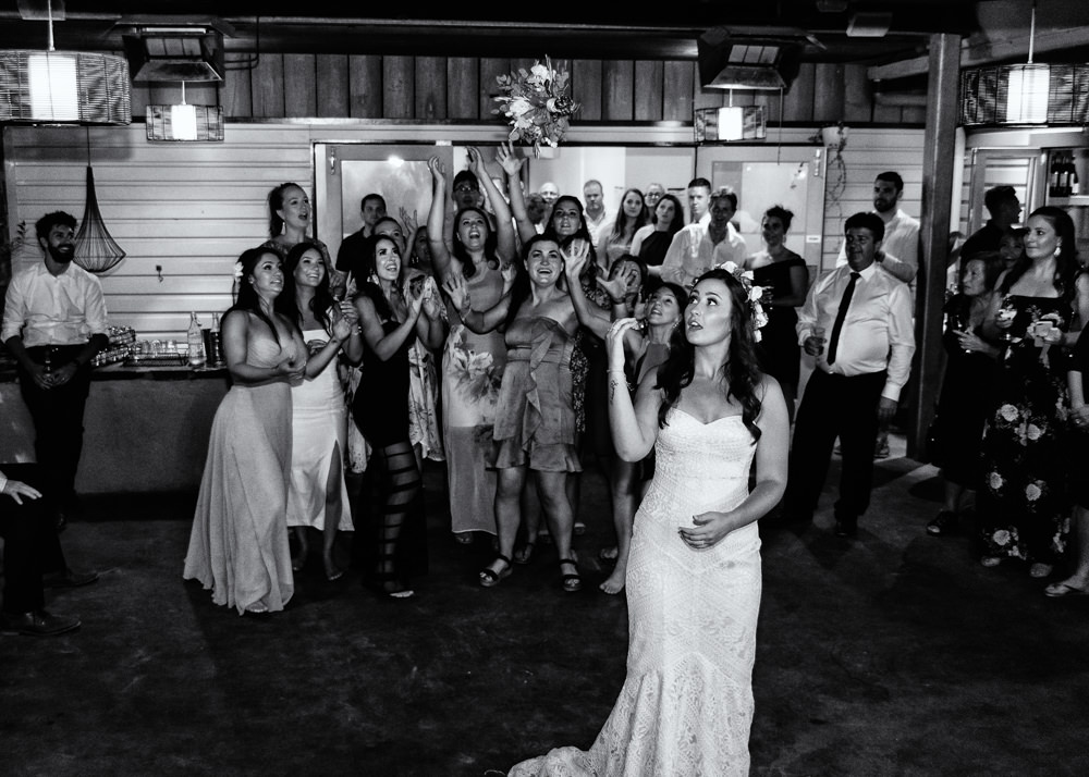 A bride throwing the bouquet at a wedding