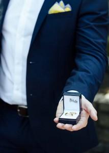 Best man, groomsman, showing off rings