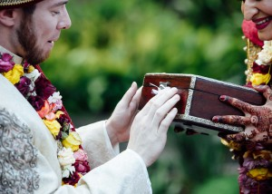 Bride and groom closing a time capsule during wedding