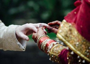 Bride puts ring on groom's finger