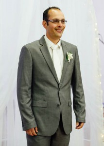Groom waiting, grey suit