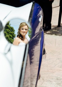 Bride reflected in car mirror