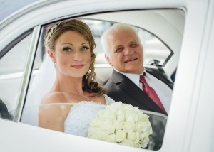 Bride and father in bridal car