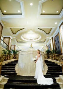 Bride and groom on staircase at Langham Hotel Melbourne