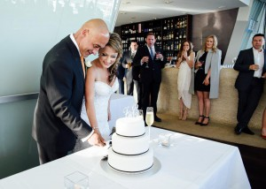Bride and groom cutting cake at Berth, Docklands