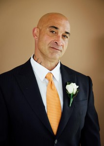 Portrait of groom with orange tie