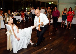 Groom removing garter at Berth Docklands Wedding