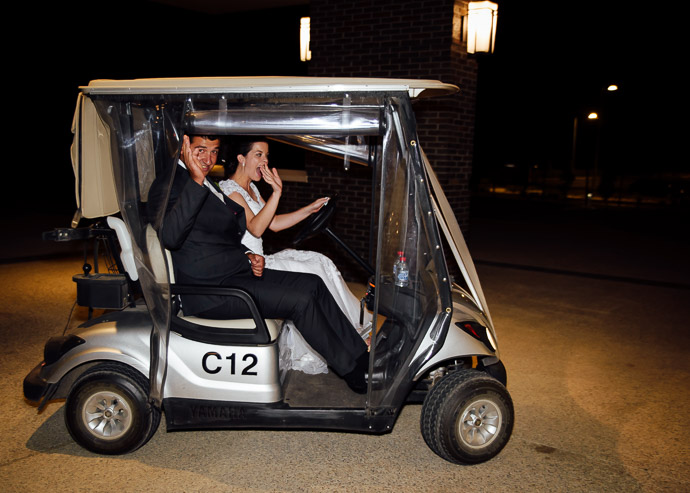 Bride and groom leave in a golf cart