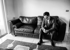 Groom on couch, sofa, black and white