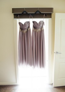 Bridesmaid dresses hanging in the window