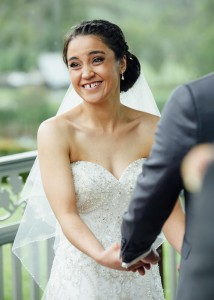 Bride smiling at guests during wedding