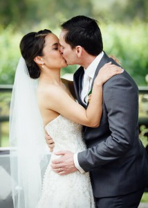 Bride and groom, vineyard wedding, first kiss