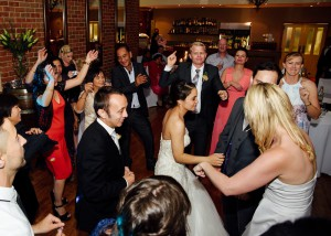 Bride and guests dancing at reception