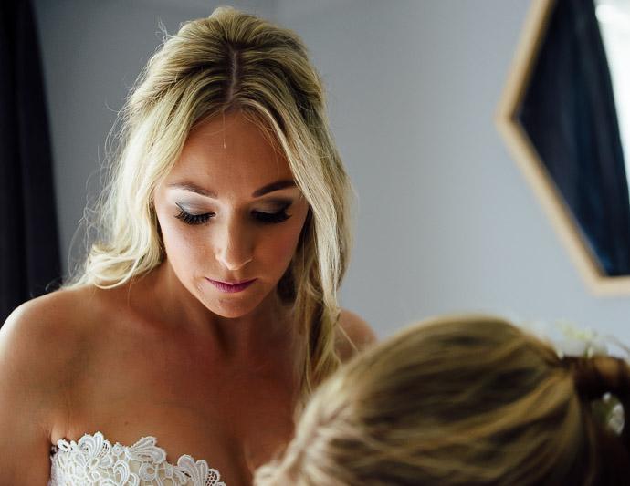 Beautiful bride Kate preparing at home