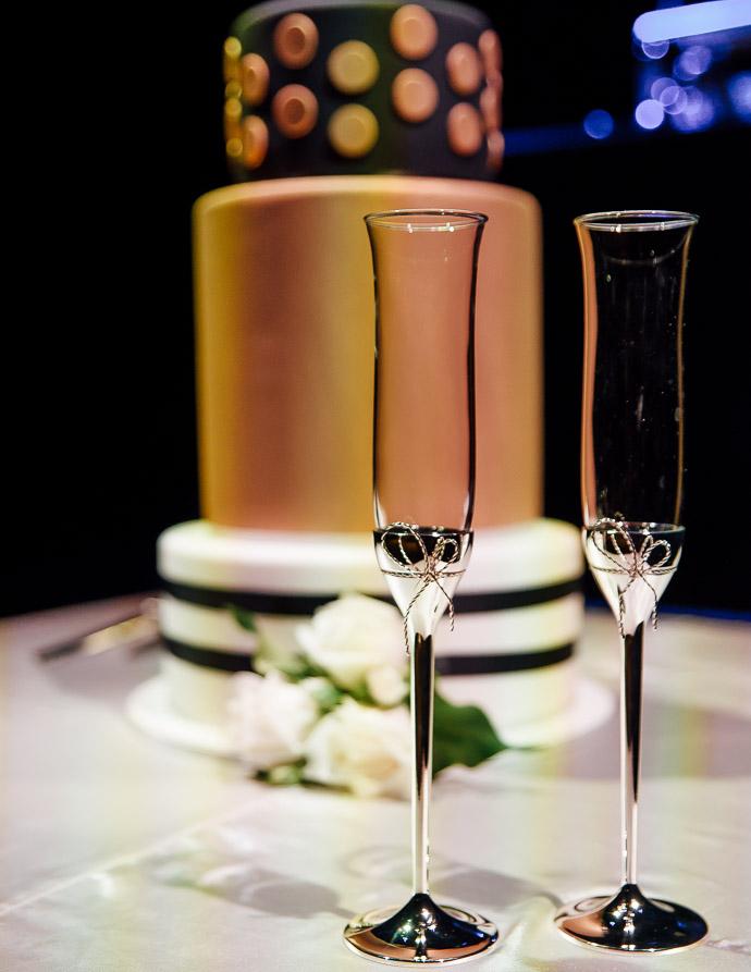 Orange ane black wedding cake, and champagne glasses