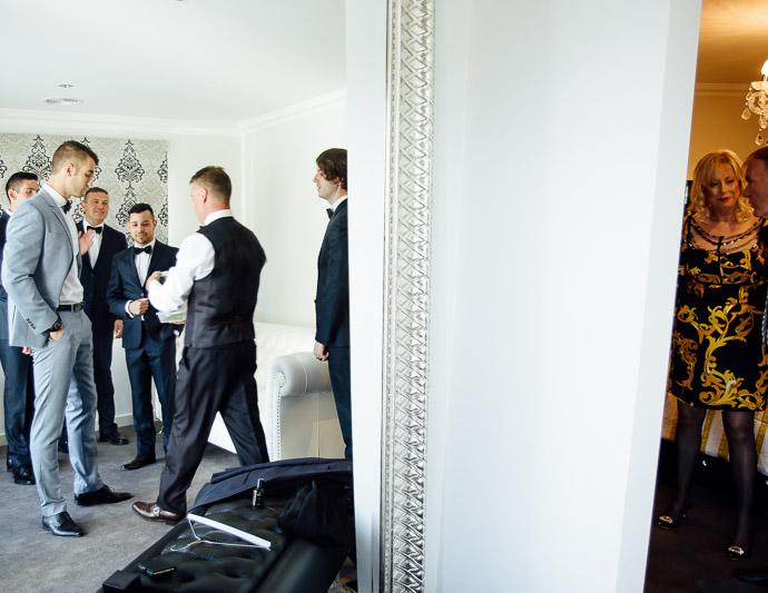 Groom and groomsmen in mirror