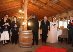 Bride walking down the aisle at Jones Road Winery