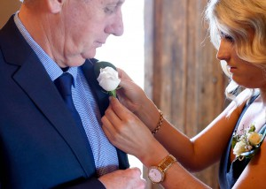 Bridesmaid-pinning-flower-to-father