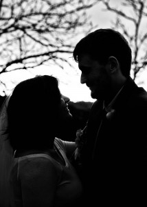 Silhouetted bride and groom