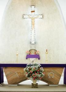 Cross and flowers inside church