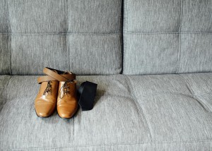 Shoes and belt on sofa, couch