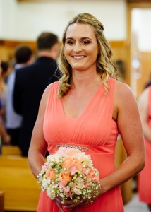 Bridesmaid in church aisle