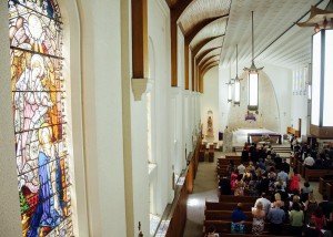 Inside the massive church, stained glass window