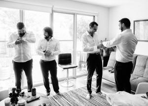 Groomsmen helping with cuff links, cufflinks