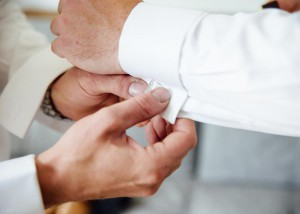 Groomsmen helping with cuff links, cufflinks