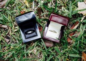 Wedding rings in boxes on the grass
