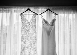 Dress hangs in window, black and white