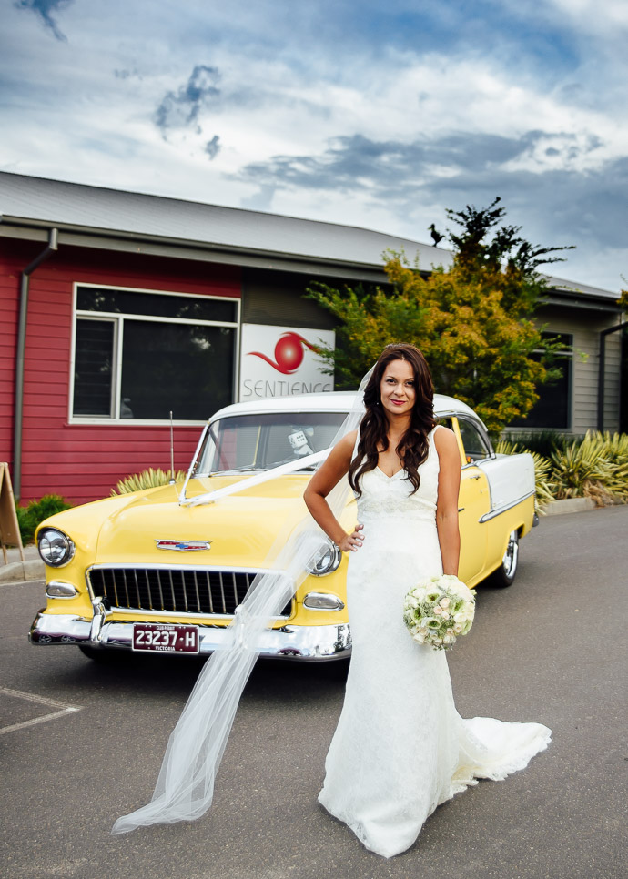 Bride in front of Yellow Chevy Bel Air