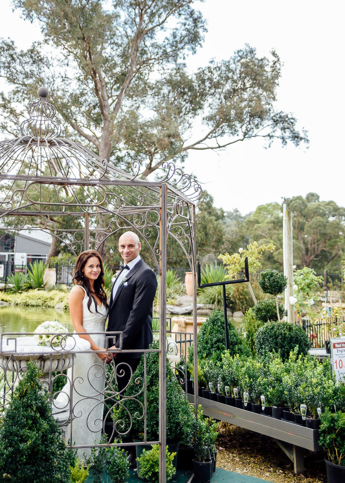 Bride and groom in arbor at Rivers of Yarrambat