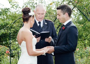 Groom holding bride's hand at Immerse