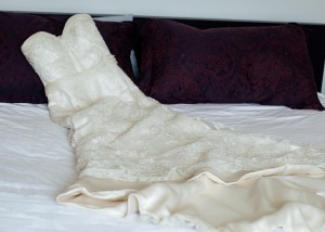Bride's dress laid out on bed